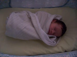 This is my son a few days after he was born. He did not weigh 60 pounds like I was expecting, actually he still doesn't.